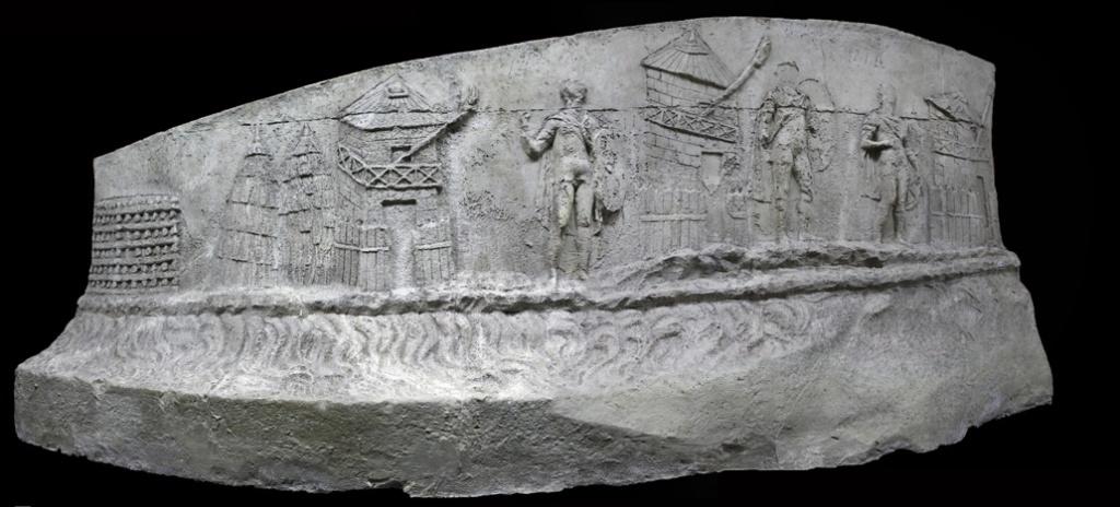 Roman sentries are depicted standing guard along the Roman side of the Danube river. Cichorius Plate IV and V, Scene 1 Coarelli (2000) Pl. 2